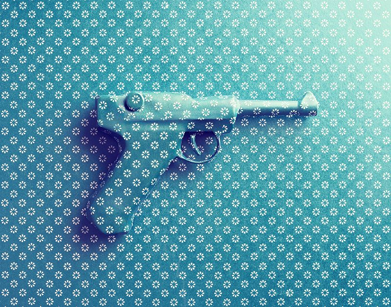 gift-wrapped gun photography
