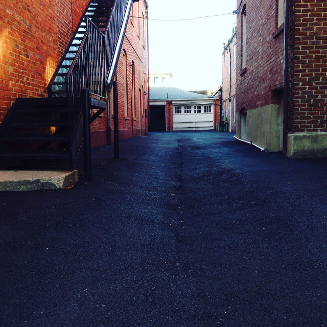 as i was taking this an old lady came out onto the stairs on the left and started yelling at me. #oldlady #artsy #alley #vscocam #vsco